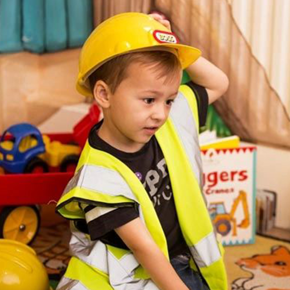 boy dressing in builders uniform