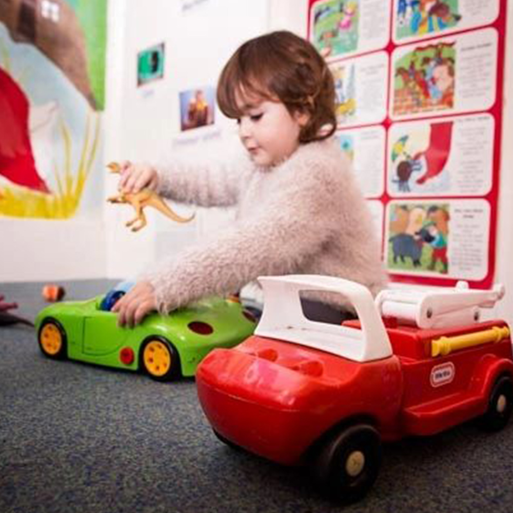 girl playing with cars